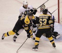 Penguins Orpik checks Bruins Corvo at TD Garden in Boston, MA.