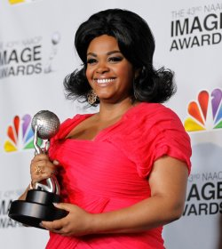 Singer Jill Scott holds her award in the press room at the 43rd NAACP Image Awards in Los Angeles