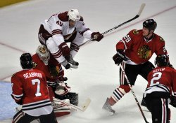 Chicago Blackhawks goalie Corey Crawford (50) makes a save on Phoenix Coyotes center Antoine Vermette in Chicago