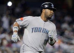 Toronto Blue Jays Edwin Encarnacion runs the bases after hitting a 2-run homer at Yankee Stadium in New York