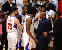Clippers' coach Doc Rivers confers with center De'Andre Jordan in Los Angeles