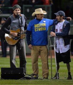 James Taylor signs duirng game 2 of the World Series in Boston