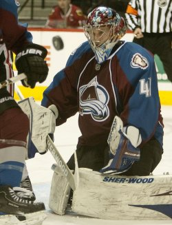 Avalanche Goalie Anderson Makes a Save Against the Blackhawks in Denver