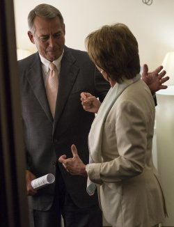 Speaker Boehner talkes to Minority Leader Pelosi in Wasington, D.C.