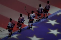 New York Islanders stand on the ice