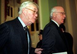 Senators Daniel Patrick Moynihan and Patrick Leahy walk to the Senate Chamber