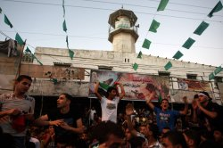 """Palestinians Celebrate After An """"Unlimited"""" Ceasefire in the Gaza"""