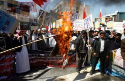 Iranian demonstrators burn the U.S. flag in front of the Bahrain embassy in Tehran