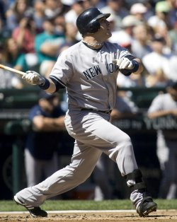 New York Yankees' Eric Hinske flies out to Seattle Mariners center fielder Franklin Gutierrez in the second inning at SAFECO Field in Seattle.