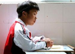 A Tibetan student studies at school in Ganzi Prefecture