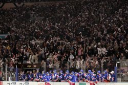 Fans react behind the New York Rangers bench at Madison Square Garden in New York