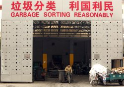 Garbage collectors deliver trash to a recyling depot in Beijing