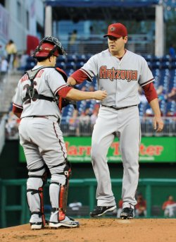 Diamondbacks Montero talks with pitcher Saunders as they play against the Nationals in Washington