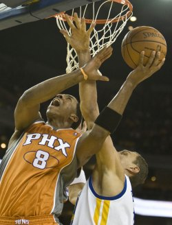 Phoenix Suns Channing Frye is fouled by Golden State Warriors Andris Biedrins in Oakland, California
