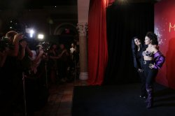 Suzette Quintanilla stands with wax statue of Selena