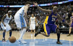 Lakers Bryant Loses Ball During the NBA Western Conference Playoffs First Round Game Four in Denver