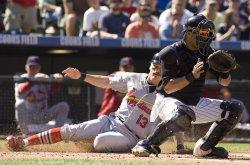 Cardinals Ryan Scores Against Rockies in Denver