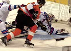 New York goalie Henrick Lundqvist is scored on by Philadelphia Flyers' Sean O'Donnell in Philadelphia