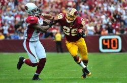 Redskins running back Roy Helu runs against Arizona Cardinals in Washington