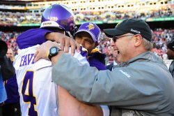 Vikings quarterback Bret Favre celebrates with new head coach Leslie Frazier in Washington