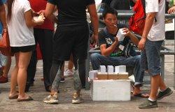 Man sells iPhone 6 on a sidewalk in Hong Kong