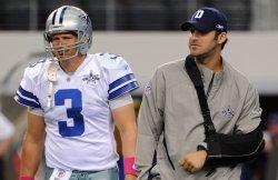 Cowboys' quarterback Tony Romo stands next to backup Jon Kitna in Texas