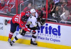 Washington Capitals' Matt Hendricks fights for the puck against Pittsburgh Penguins Matt Niskanen in Washington