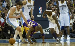 Lakers Bryant Loses Ball to Nuggets Gallinari and Lawson During the NBA Western Conference Playoffs First Round Game Six in Denver