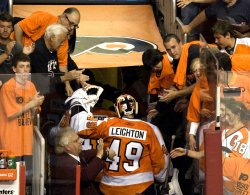 Philadelphia Flyers' goalie Michael Leighton leaves the ice after winning game three of the Stanley Cup Playoffs