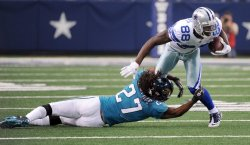 Dallas Cowboys Dez Bryant gets wrapped up by Jacksonville Jaguars Rashean Mathis