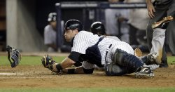 New York Yankees Francisco Cervelli tags out Baltimore Orioles Miguel Tejada at Yankee Stadium in New York