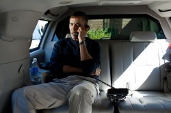 President Barack Obama talks on the phone with Afghanistan President Hamid Karzai in Maryland