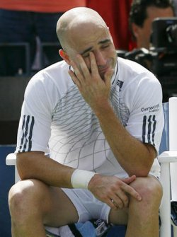 ANDRE AGASSI PLAYS THE FINAL MATCH OF HIS CAREER AT THE 2006 U.S.OPEN