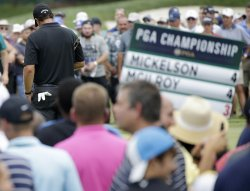 Phil Mickelson stands on the 3rd green at 4 over par
