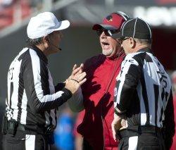 Arizona Cardinals Head Coach Bruce Arians argues with officials