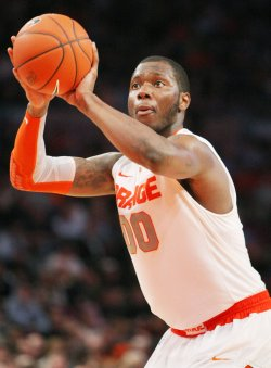 Rick Jackson of Syracuse takes on St. John sat NCAA Big East Basketball Championship in New York