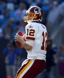 Washington Redskins quarterback John Beck (12) looks to pass against the Carolina Panthers