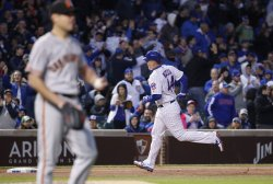 Cubs Anthony Rizzo runs the bases after hitting a home run in Chicago