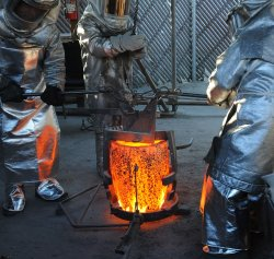 Workers pour molten bronze into molds to cast SAG Award stauettes in Burbank, California