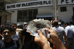 Palestinian Employees Wait in Front of Bank of Palestine to Withdraw Their Salaries