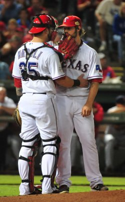 Rangers Rangers catcher Mike Napoli and pitcher C.J. Wilson confer on the mound in game 5 of the World Series in Texas