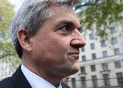 Liberal Democrat Chris Huhne leaves meeting with Conservatives.