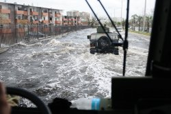 Members of the Puerto Rico National Guard Patrol the Flooded Streets of Puerto Rico