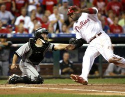 Philadelphia Phillies Ryan Howard is out at first during first inning