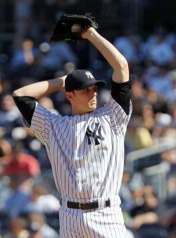 New York Yankees relief pitcher David Robertson reacts at Yankee Stadium in New York