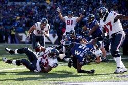 Texans' Arian Foster runs for a 1-yard touchdown in Baltimore
