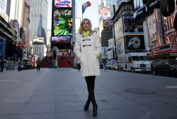 Entertainment Tonight's Lara Spencer stands in Times Square in New York City