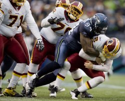 Washington Redskins quarterback Rex Grossman is sacked by Seattle Seahawks defensive end Anthony Hargrove in Seattle