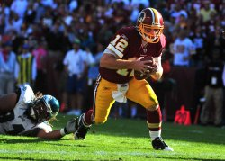 Redskins' quarterback John Beck scrambles for a touchdown in Maryland