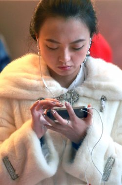 A Chinese woman checks out Apple's iPhone 5S in Beijing